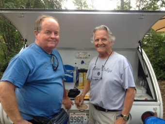 "Mike Smith and I taking a photo-op break before opening a bottle of wine. Note the Alaska decal between us. I gave each of us one to show ""we made the drive."""