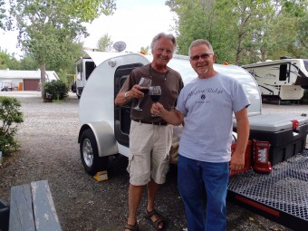 My travel partner, John Lewis and I sharing a bottle of wine our first night on the road in Cache Creek, BC.
