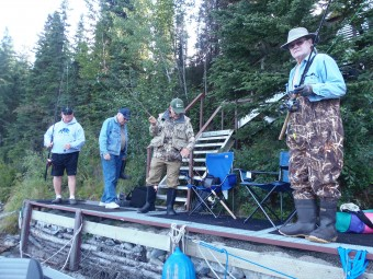 Mike, Tom, John, and Sherm getting their poles ready for a day of fishing.